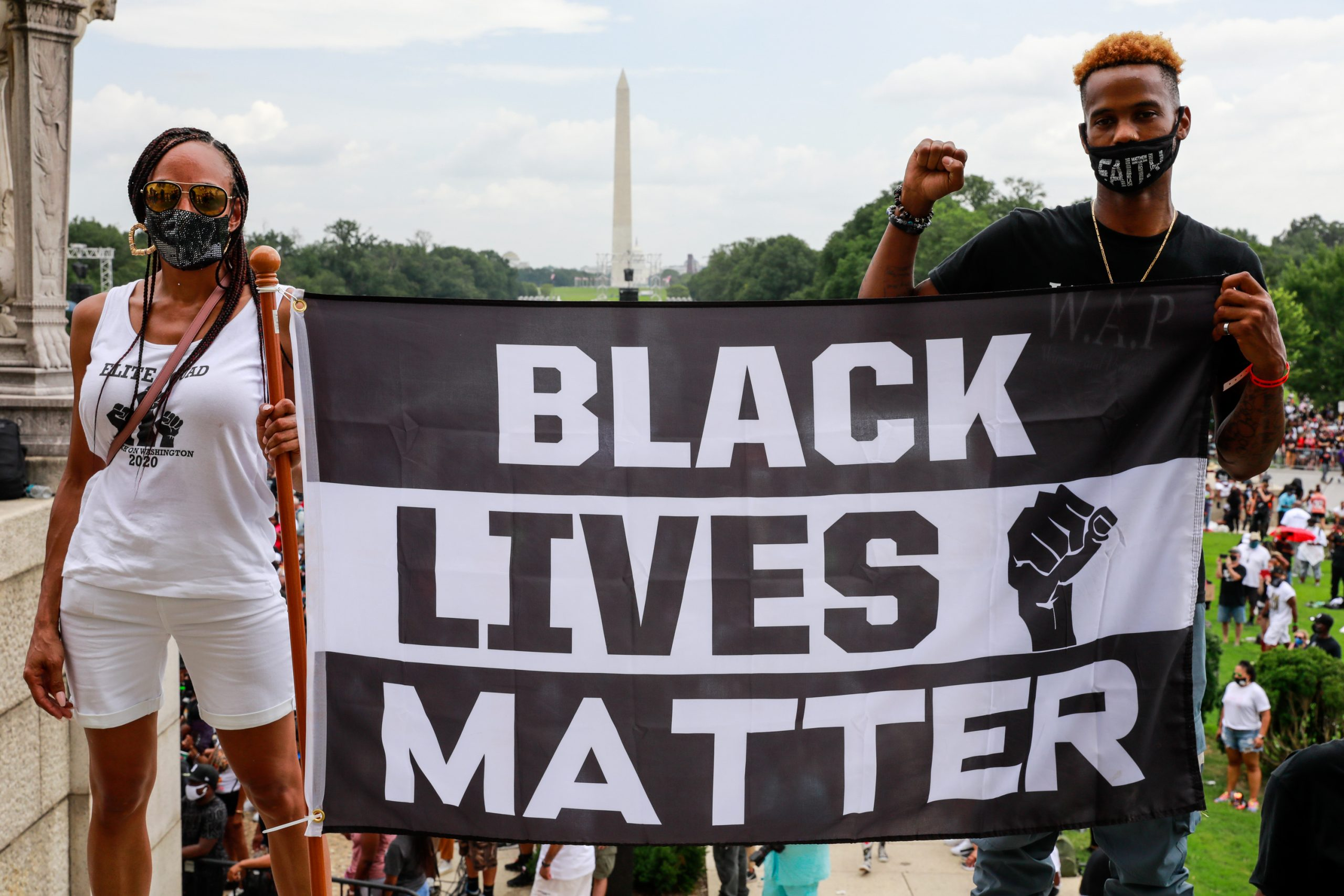 Protesters hold a Black Lives Matter banner during an August 2020 march in Washington D.C.